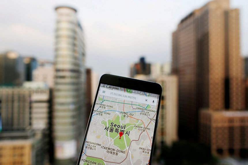 A 2016 photo illustration shows the Google Maps application on a smartphone in central Seoul, South Korea.