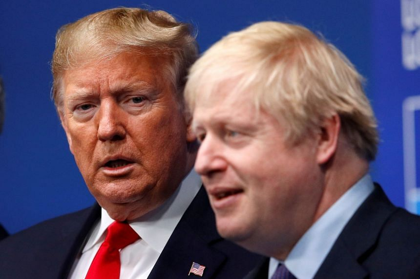 Johnson (right) welcomes Trump at the Nato leaders summit in Watford, England on Dec 4, 2019.
