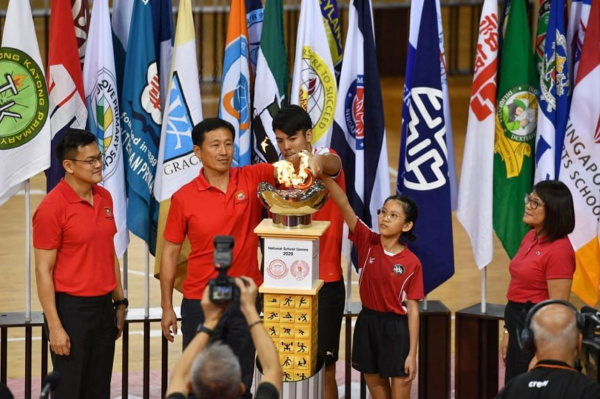 (From left) Tony Low, chairman of Singapore School Sports Council; Education Minister Ong Ye Kung; Zikos Chua (football) from Nanyang JC; Adelina Cheok (rope skipping) from Edgefield Primary; Singapore Primary School Sports Council chairman Lee Hui F