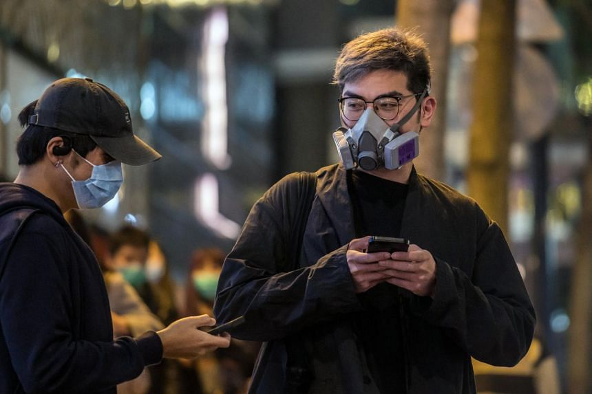 Pedestrians wear protective face masks in Hong Kong on Feb 6, 2020.