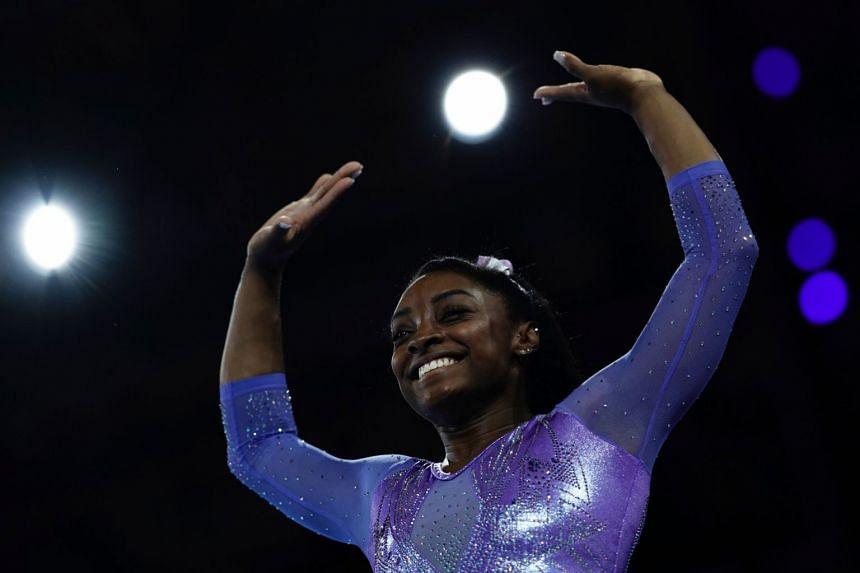 Biles performs on the floor during the apparatus finals at the FIG Artistic Gymnastics World Championships in Germany.