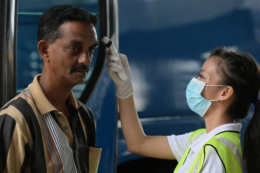 A bus driver having his temperature checked at the Woodlands Checkpoint on Feb 1, 2020.