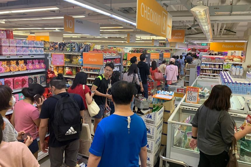 A queue at the FairPrice Finest outlet at Junction 8 in Bishan on Feb 7, 2020.