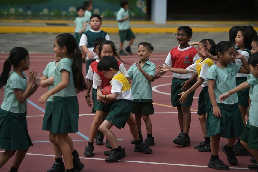 Students from Farrer Park Primary School playing at the quadrangle of the school, on Feb 7, 2020.