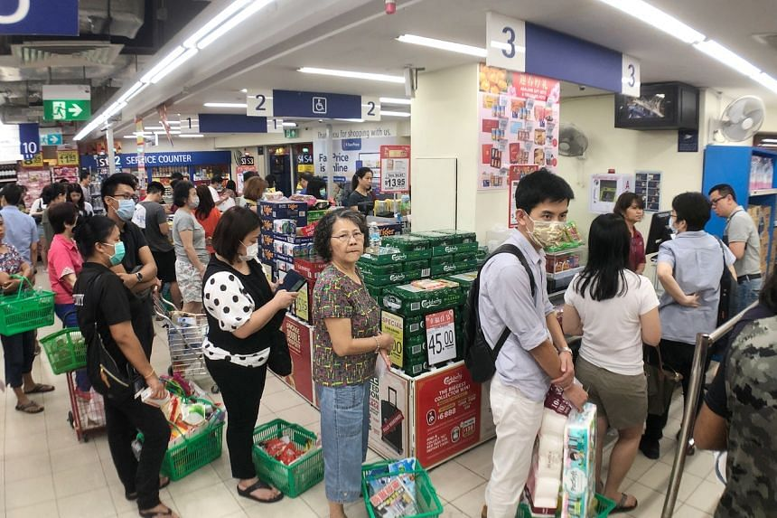 A queue at the FairPrice outlet at the HDB Hub in Toa Payoh on Feb 7, 2020.