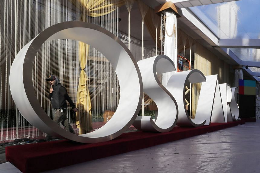 Workers continue preparations on the red carpet for the 92nd annual Academy Awards ceremony at the Dolby Theatre in Hollywood, California, on Feb 6, 2020.