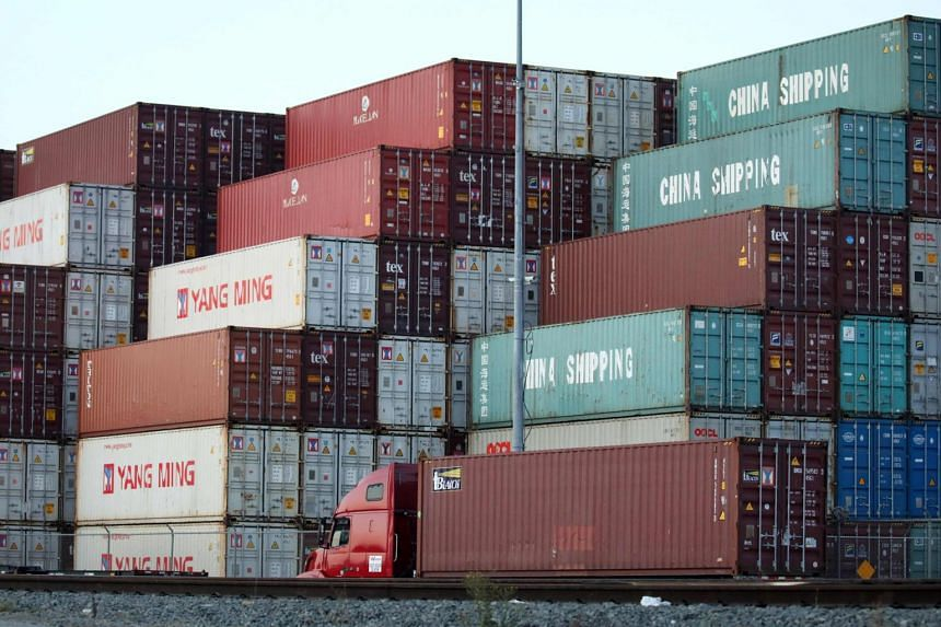 Shipping containers stacked at the Port of Los Angeles, in California, on Nov 6, 2019. Shipping lines are rerouting cargoes and reducing calls to Chinese ports, setting the scene for months of delivery delays ahead, industry sources said.