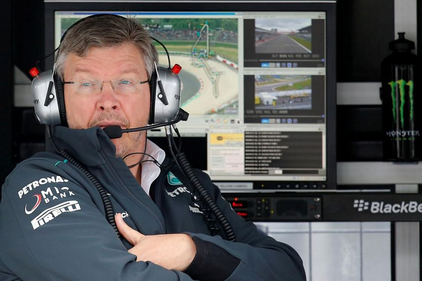 In a file photo taken on July 5, 2013, then-Mercedes Formula One team principal Ross Brawn looks on during the first practice session of the German F1 Grand Prix at the Nuerburgring racing circuit.