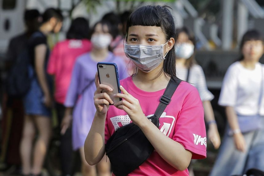 A Chinese tourist wears a protective mask at a public park in Colombo, Sri Lanka, Feb 7, 2020.