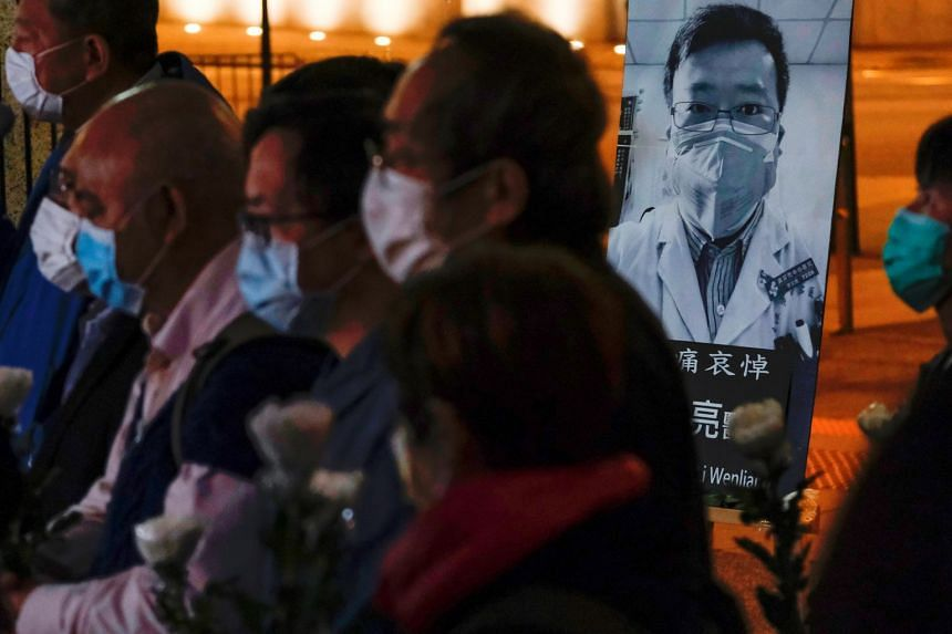 People in Hong Kong attend a vigil for Dr Li Wenliang, who died of coronavirus at a hospital in Wuhan..
