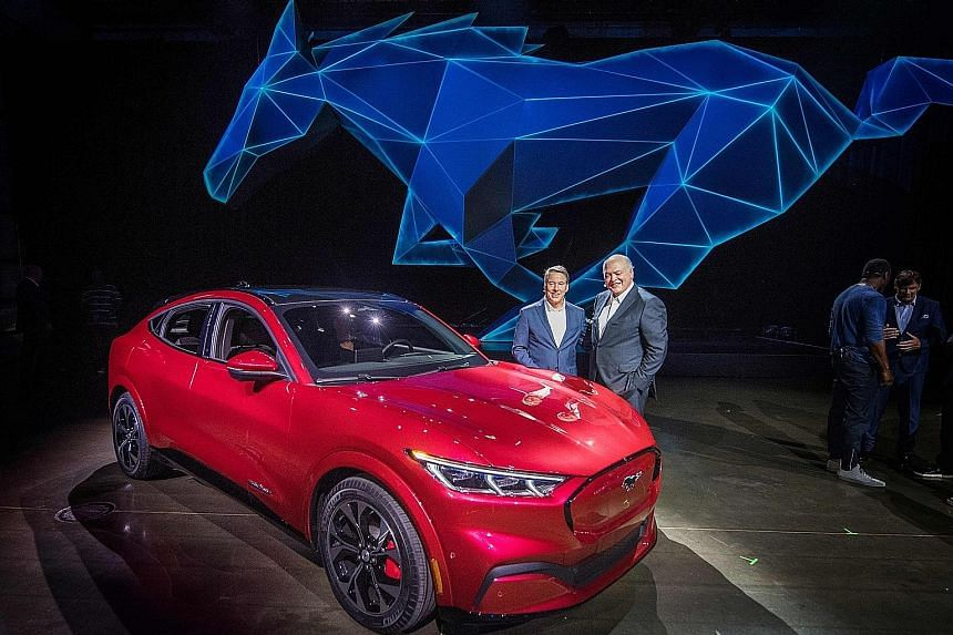 Ford's CEO James Hackett (right) and a team member revealing the company's first mass-market electric car, the Mustang Mach-E, at an event in California last November. Under Mr Hackett's watch, Ford lost US$1.7 billion (S$2.36 billion) in last year's