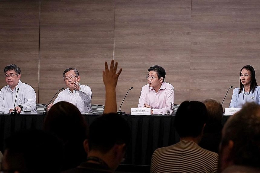At the multi-ministry task force news conference yesterday were (from left) MOH director of medical services Kenneth Mak, Health Minister Gan Kim Yong, National Development Minister Lawrence Wong and Education Ministry director of schools Liew Wei Li