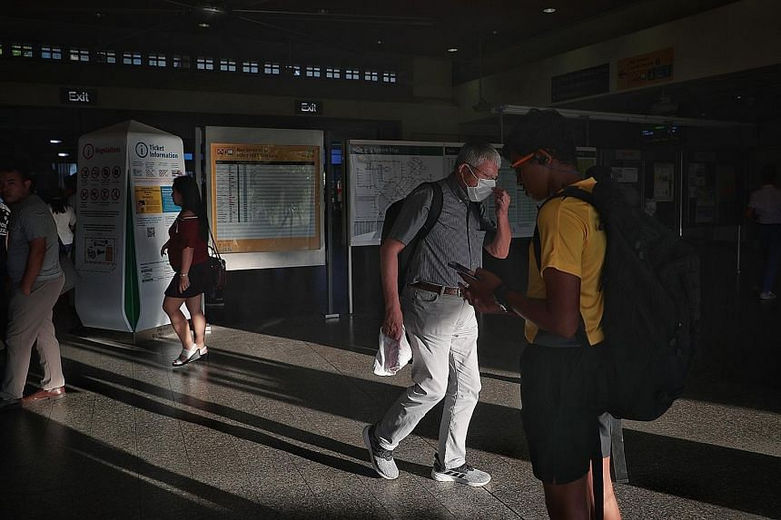 A commuter wearing a mask at Pasir Ris MRT station yesterday. The Health Ministry has continued to advise those who are unwell to stay home. If they must go out, they should wear a mask and avoid coming into close and sustained proximity with others.