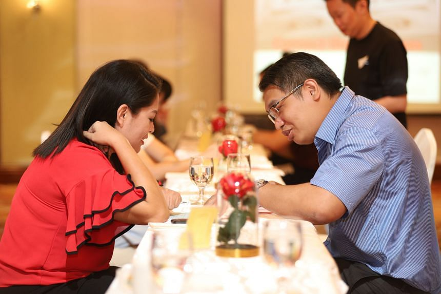 Mr Samuel Lai (right), a 36-year-old engineer at a DNA-based speed-dating event held at Holiday Inn Orchard City Centre, on Dec 2019.