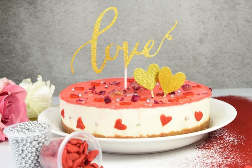 """Until Feb 14, each cheescake from Cat & The Fiddle will come with complimentary red heart sprinkles, silver dragees and a """"Love"""" cake topper."""