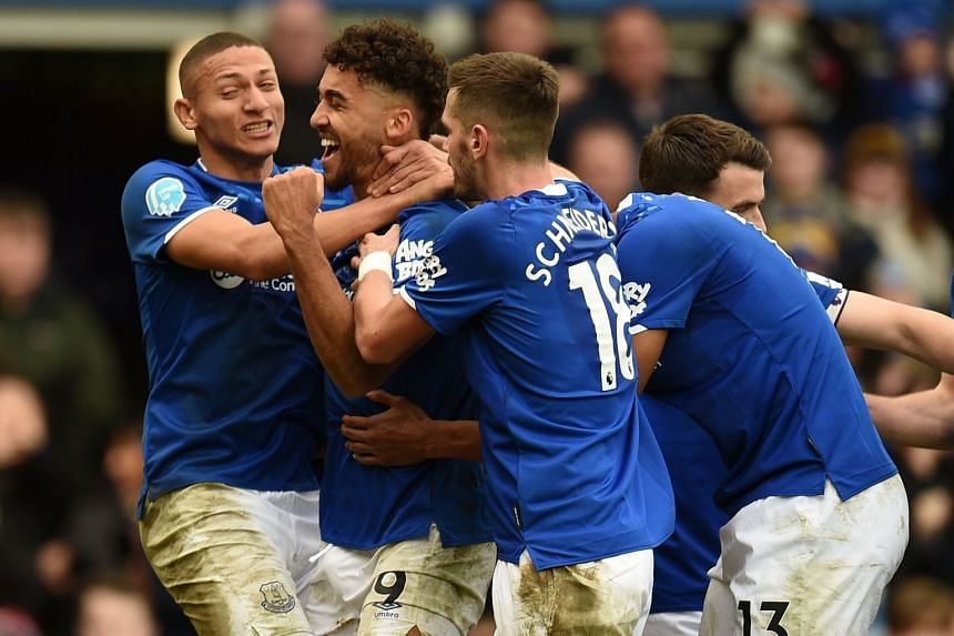 Everton's Dominic Calvert-Lewin (second left) celebrates with Richarlison (left) and team mates after scoring their third goal.