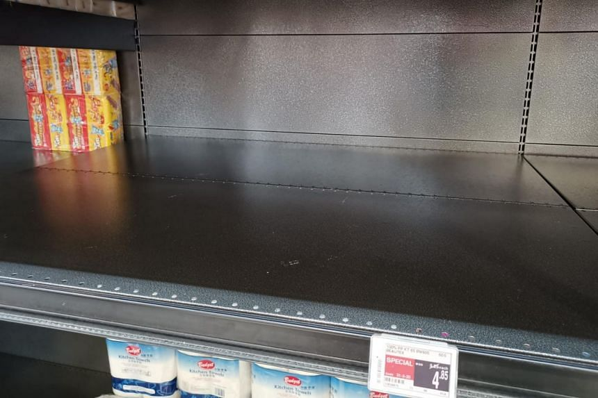 Empty shelves at the FairPrice Xtra outlet at Ang Mo Kio Hub on Feb 7, 2020.