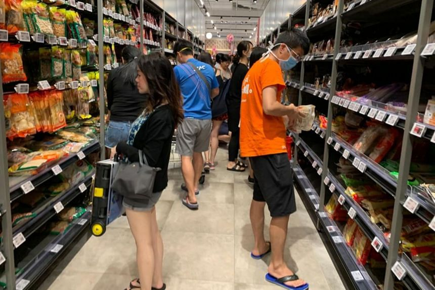 Shoppers at the FairPrice Xtra outlet at VivoCity on Feb 8, 2020.