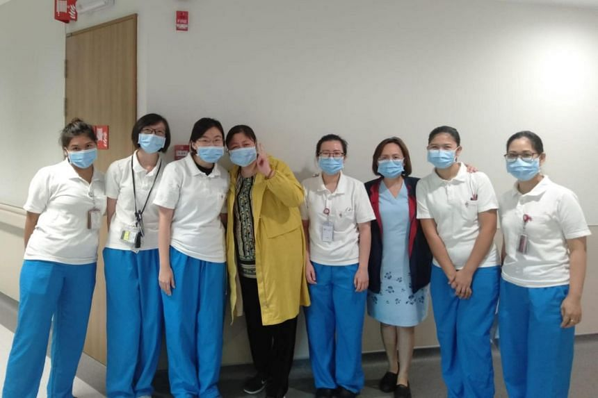 (Fourth from left) Ms Jiang poses for a photo with nurses and doctors at the National Centre for Infectious Disease.