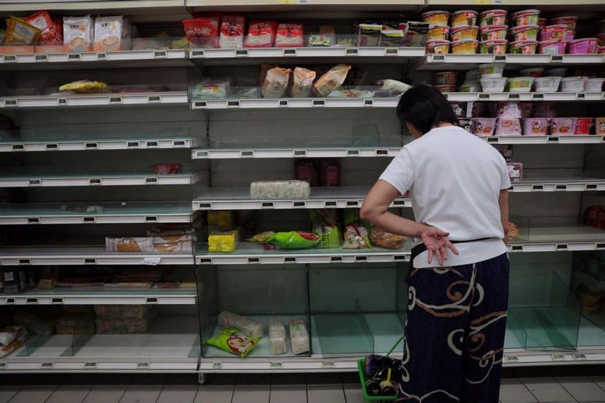 Empty shelves at the Fairprice outlet at White Sands in Pasir Ris on Feb 7, 2020.
