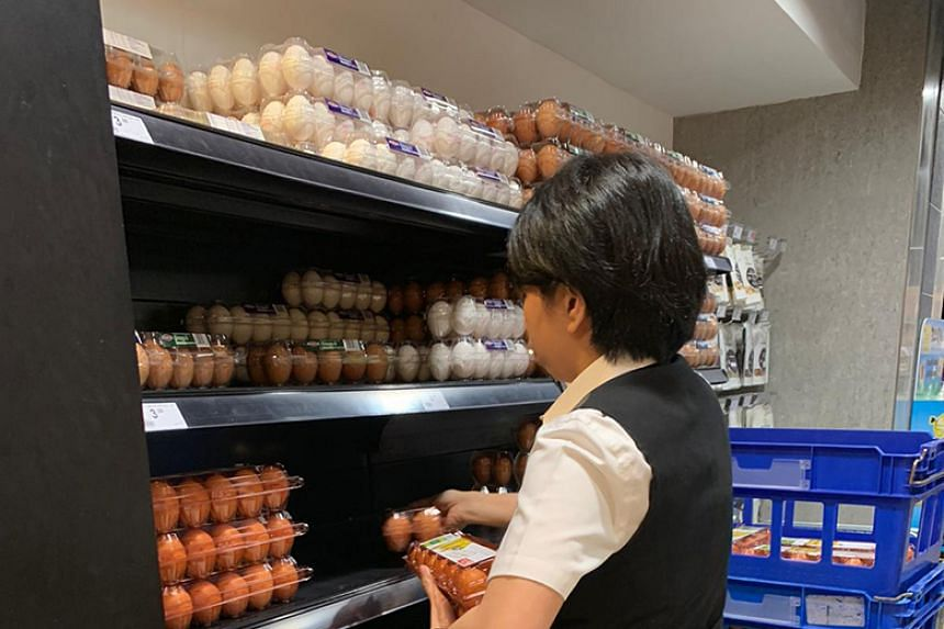 An employee restocks a shelf at Paragon Market Place on Feb 8, 2020.
