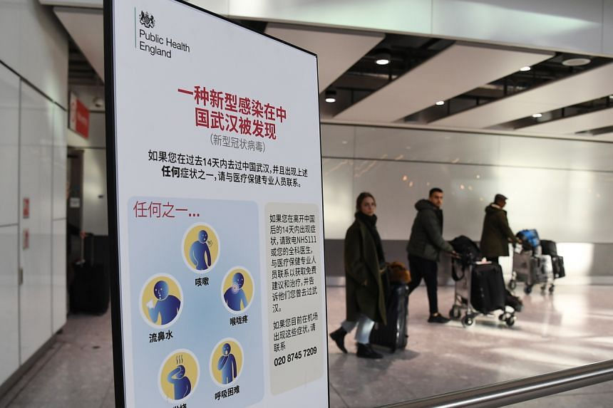 A coronavirus healthcare notice at Heathrow Airport in London. Five British nationals including a child have been diagnosed with the coronavirus in France.