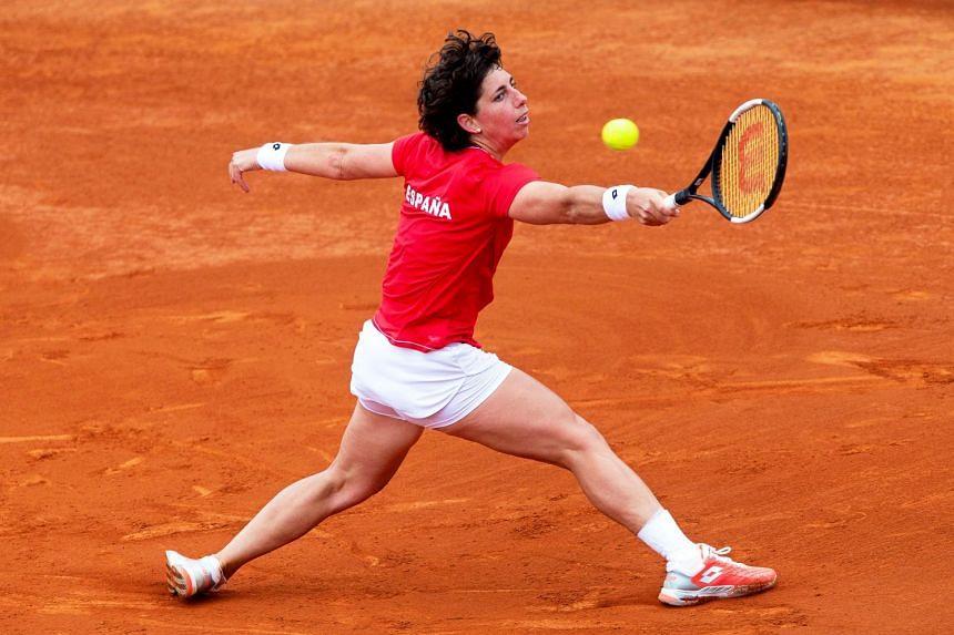 Spain's Carla Suarez Navarro in action against Misaki Doi of Japan in their Fed Cup play-off tie at La Manga tennis club in Atamaria, near Cartagena, on Feb 8, 2020.