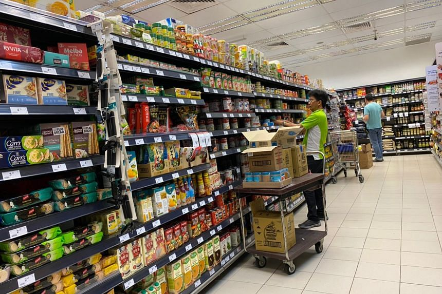 An employee working to restock shelves at the Cold Storage supermarket in Clementi Arcade on Feb 8, 2020.