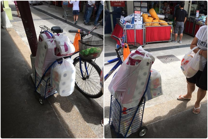 At FairPrice in Beo Crescent, many trolleys were packed with toilet rolls.