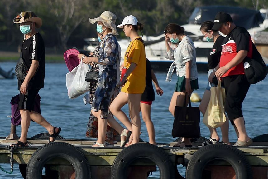 A photo taken on Jan 27, 2020, shows tourists at the fast boat pier in Serangan island in Denpasar, on Indonesia's resort island of Bali.