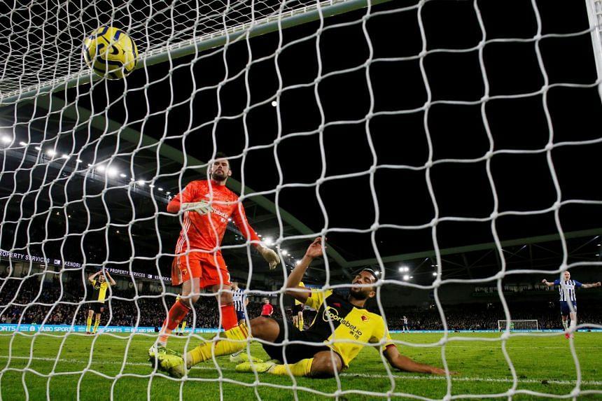 Watford's Adrian Mariappa scores an own goal.