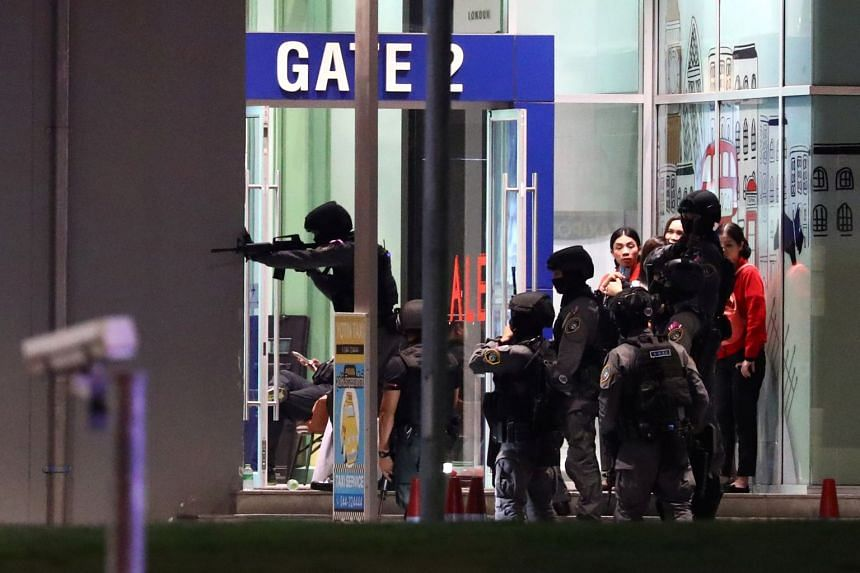 Thailand security forces enter the shopping mall as they hunt the shooter.