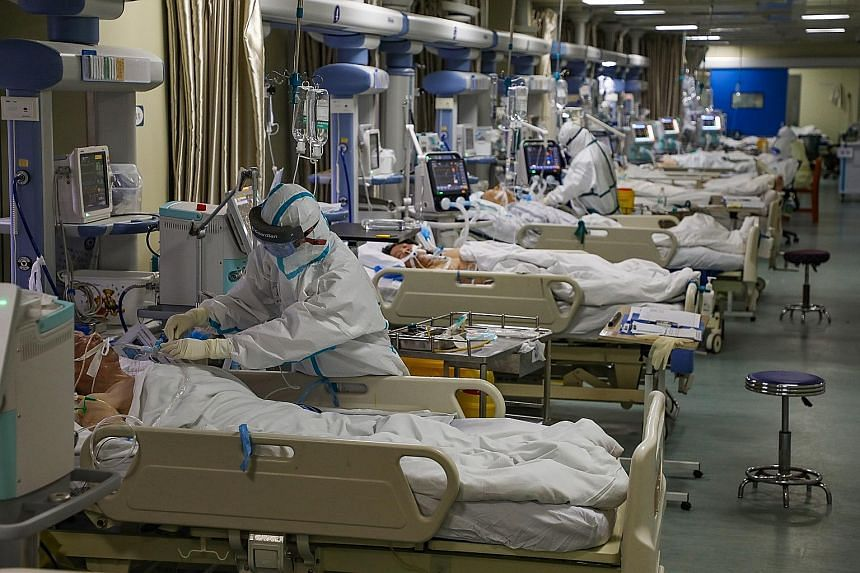 Medical staff working in the isolated intensive care unit in a hospital in Wuhan on Thursday. Most of the deaths in China from the coronavirus have occurred in and around Wuhan in central Hubei province. PHOTO: EPA-EFE