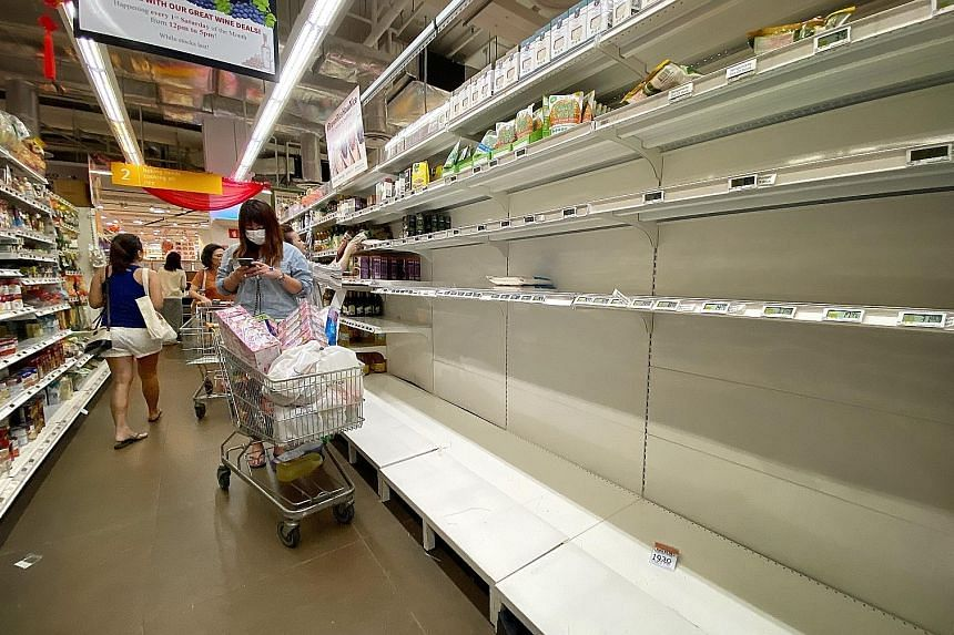 The FairPrice Finest outlet at myVillage in Serangoon Gardens. Toilet paper rolls, rice, instant noodles and cooking oil were among the items flying off supermarket shelves.
