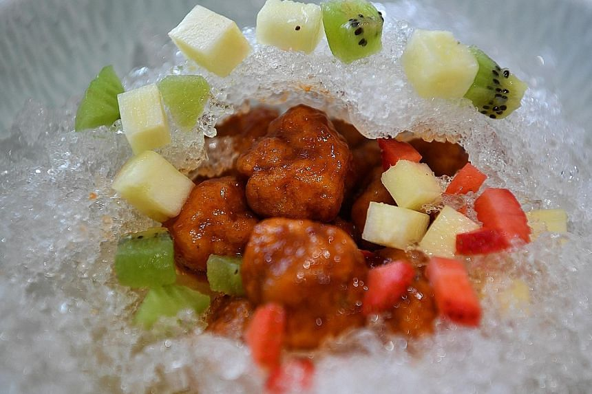 Chef Pung Lu Tin of Tasty Loong gets about 100 orders a week for his sweet and sour pork on ice (above).