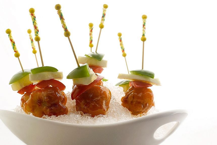 Kai Garden's version (above) serves the pork cubes with pineapple and bell peppers and are skewered for easy eating.
