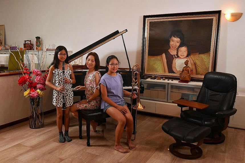 Mindfulness practitioner and life coach Sofie Hon with her daughters, Rebecca (standing) and Alyson Lim. When her daughters' primary school shifted back to its original site, the family decided to move closer to the school for logistical reasons. It is no