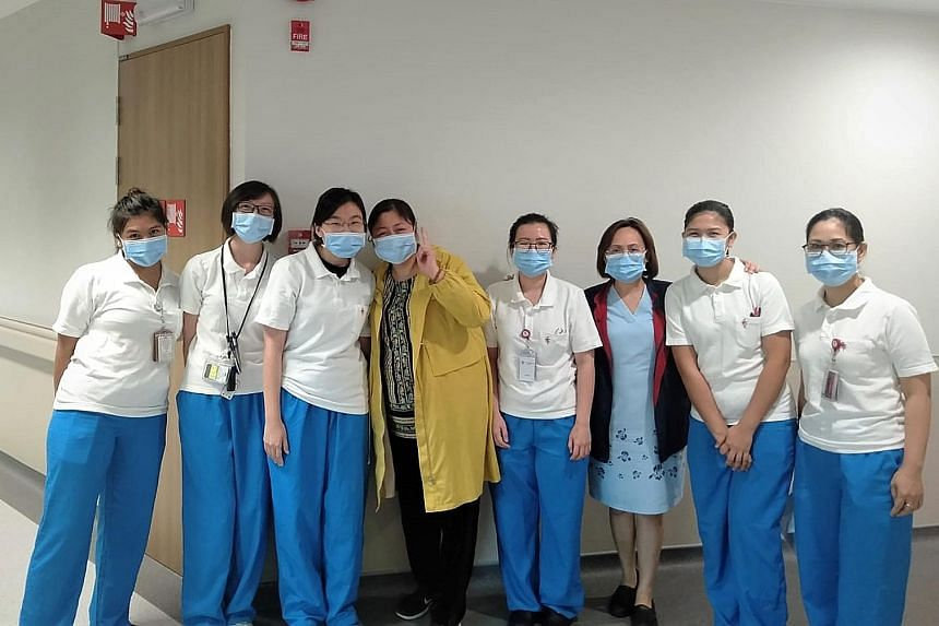Ms Jiang (fourth from left), diagnosed with the coronavirus infection after arriving in Singapore for a holiday, posing for a photo with doctors and nurses at the National Centre for Infectious Diseases to thank them for caring for her when she was w