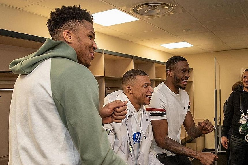 """SWEET TWEET """"Paris was LIT! What a night @k.mbappe X #PSGWoah"""" Milwaukee's Giannis Antetokounmpo and his brother Thanasis get their moves on with PSG's hotshot during the Bucks' NBA game in Paris."""