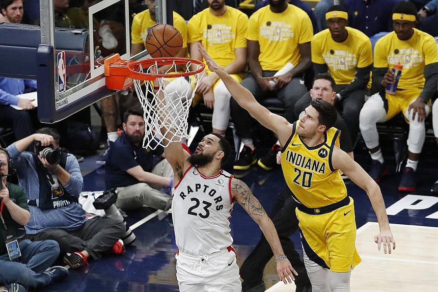 Toronto guard Fred VanVleet taking a shot as Indiana forward Dough McDermott defends during their NBA game at Bankers Life Fieldhouse in Indianapolis. The visitors won 115-106. PHOTO: REUTERS
