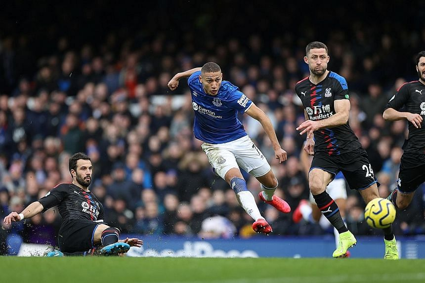 Richarlison evading two Crystal Palace defenders following a solo run to score the second goal in Everton's 3-1 Premier League victory just before the hour yesterday. Another Brazilian Bernard had given the Goodison Park hosts the lead with a volley