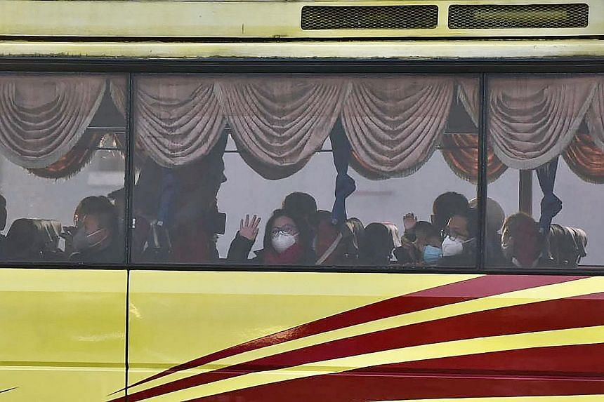 Malaysian nationals on a bus after being evacuated from Wuhan in China and arriving at Kuala Lumpur International Airport in Sepang last Tuesday.