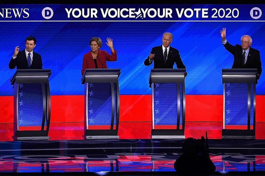 Candidates for the Democratic presidential nomination (from left) Pete Buttigieg, Elizabeth Warren, Joe Biden and Bernie Sanders during the primary debate at Saint Anselm College in New Hampshire on Friday. PHOTO: AGENCE FRANCE-PRESSE