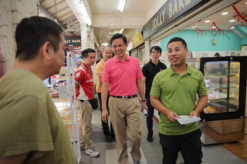 Minister for Social and Family Development Desmond Lee (right, in green) and Minister for Trade and Industry Chan Chun Sing (centre) during their Ministerial Community Walkabout to Jurong Spring on Feb 9, 2020.
