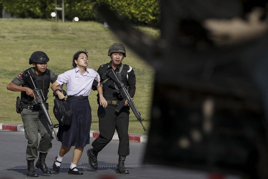 Soldiers evacuate a hostage from the scene of a mass shooting at the Terminal 21 shopping mall in Nakhon Ratchasima, Thailand, on Feb 9, 2020.