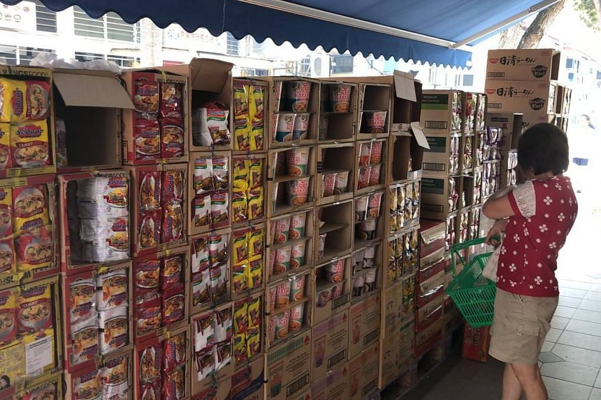 Boxes of instant noodles placed outside a Fairprice outlet in Whampoa, on Feb 9, 2020.