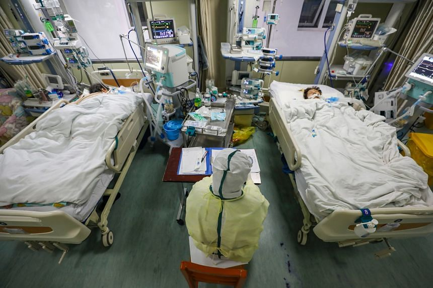 A medical staff member works in the isolated intensive care unit in a hospital in Wuhan on Feb 6, 2020.
