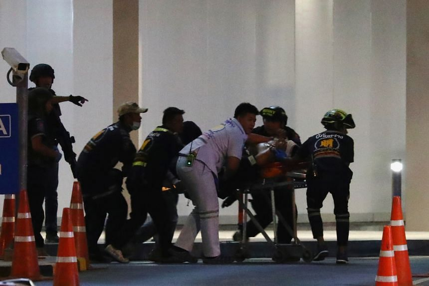An injured member of the Thai security forces is stretchered out after a raid inside the Terminal 21 shopping mall to try to stop a soldier on a rampage after a mass shooting in Nakhon Ratchasima, Thailand, on Feb 9, 2020.
