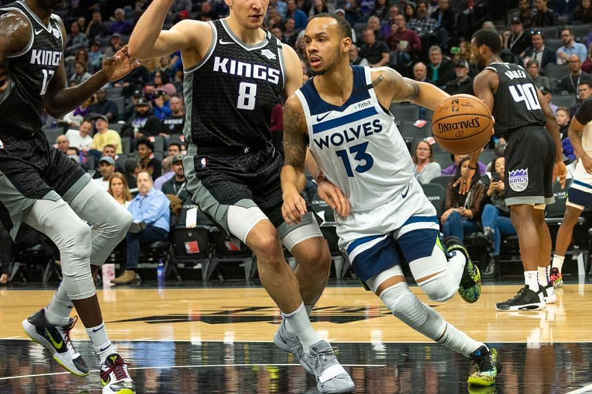 Minnesota Timberwolves guard Shabazz Napier (right) drives to the basket against Sacramento Kings guard Bogdan Bogdanovic during the first quarter at Golden 1 Center on Feb 3, 2020.