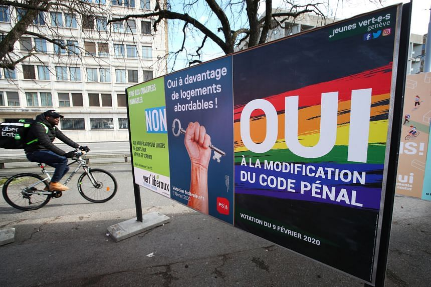 A poster in favour of the change of the penal code is pictured ahead of a referendum on anti-homophobia law in Geneva, Switzerland, on Feb 6, 2020.